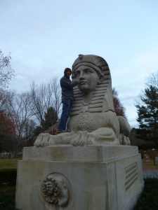 Paul picking the sphinx's nose at St. Auburn Cemetery in Cambridge