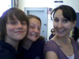Me, in my twenties, with middle schoolers.  Yes, I sometimes wore a side-ponytail at school.