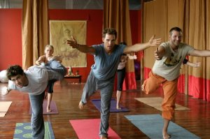 Bradley Cooper (far right) doing yoga with Justin Bartha and Matthew McConaughey. Photo from coolspotters.com.