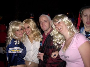 "Hugh Hefner and the ""girls next door."""