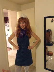 Me dressed as Jon Benet Ramsey and/or a cowgirl princess.  (I'm wearing sparkly cowboy boots.)