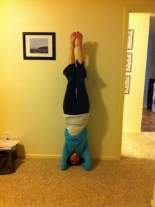 Eva doing a headstand in her bedroom.