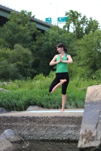 Eva doing tree pose by the James River.