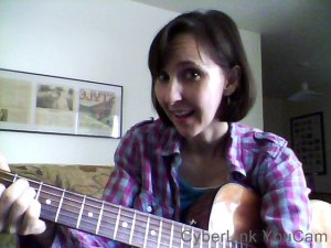 Eva with her guitar (and flannel shirt -- I'm so Seattle!)
