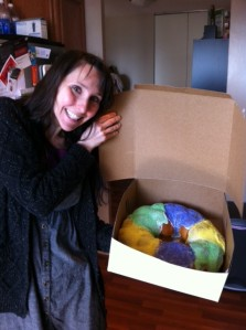 I am quite pleased with what my fiance got me for Valentine's Day:  a King Cake!  Happy Mardi Gras!