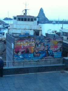 A painted boat in the harbor of Aci Trezza.