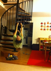 Here I am in my pajamas, hanging from the staircase in my apartment...instead of writing!